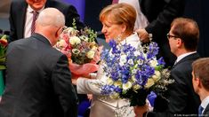 Angela Merkel elected to fourth term as German chancellorhttp://p.dw.com/p/2uHXJ