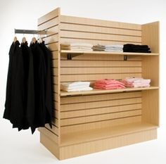 Gondola Slatwall Merchandiser Maple This high quality high slatwall gondola floor display handles a variety of standard slatwall accessories. Features 48 square feet of display area. All colors are Melamine. Color is Maple. Wire Shelving Units, Retail Shelving, Shelves, Melamine Wood, Modern Store, Clothing Displays, Clothing Racks, Flooring Sale, Shop Fittings