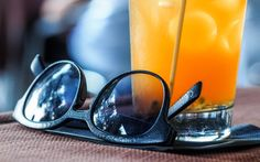 Sunglasses aka shades with a drink in Como