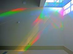 solar spectrum light painting on wall of library rainbow art installation. Erskine Solar Art