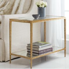 Modern History Sculpture Rectangular Side Table in Textured Antique Brass A modern classic, this elegant accent table features a textured antique brass finish and measures x x The top is glass and the bottom is antique mirrored glass. Modern Classic, All Modern, Antique Mirror Glass, Antique Brass, Glass Top End Tables, Modern End Tables, Side Tables, Black Floor Lamp, Modern History