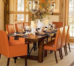Pottery Barn's Benchwright's Dining Room table with orange leather chairs...My dream table...