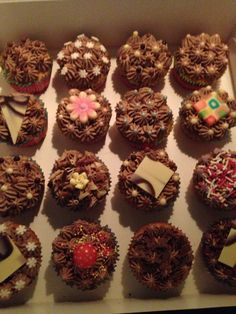 Vanilla cupcakes, chocolate buttercream and chocolate decoration