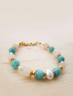 He encontrado este interesante anuncio de Etsy en https://www.etsy.com/es/listing/212390303/pearl-bracelet-amazonite-bracelet-pink