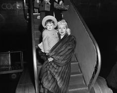 New York, NY- Lovely Lana Turner drapes her mink coat over daughter Cheryl's legs to protect them from the early morning cold as they arrive at La Guardia Field aboard a TWA Constellation from the West Coast. Cheryl Crane, Lana Turner, Love Scenes, Old Hollywood Glamour, Lanai, Stock Pictures, Image Collection, Movie Stars, Daughter