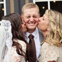 Must have photo! Groom with his two favorite ladies - his bride and his mom!