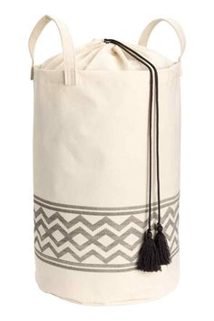 Laundry bag in patterned ecru cotton twill. Top section in thinner fabric with a drawstring closure, two handles and a plastic coating on the inside. Plastic Coating, Music Gifts, Bathroom Kids, Basket Decoration, Fabric Storage, Aesthetic Bedroom, White Houses, H&m Online, Storage Baskets