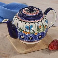"In the small village of Boleslawiec, Poland, hundreds of skilled artisans continue the tradition of Polish folk art. The unique clay, glaze and high firing temperatures result in pottery of enormous durability. This polish stoneware teapot adds a colorful note to teatime with our beautifully patterned teapot. For brewing tea only, not for use on stovetop. 5-cup capacity, 5.75"" high."