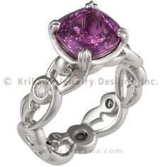 Wide Delicate Leaf Engagement Ring with Purple Sapphire - This unique design is inspired by nature and features a stylized floral leaf design. The curving tendrils of the band embrace eleven accent diamonds. The setting is a modified prong setting with carved detailing. Ideal cut accent diamonds.   - This flower engagement ring has a purple sapphire.