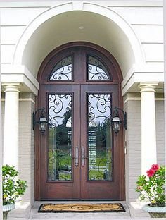Mahogany Entry door with full lites, rabbited radius transom, wrought iron grilles and Rocky Mountain hardware