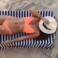 Napping on the beach in a L*Space Chloe Wrap Bikini Top.