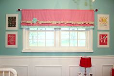 Adorable ruffled valance in this aqua and pink nursery