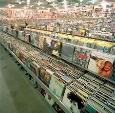 Flipping through albums in a record store.