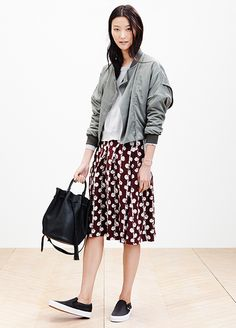24 Reasons To Trust Your Style Instincts #refinery29  http://www.refinery29.com/madewell-spring-2014#slide4  Forget heels with your feminine skirts; sneakers are better for twirling anyway.