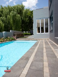 Contemporary design with contrasting colours and sizes achieved with Bosun's Urban paving range. Pool Paving, Light Colors, Colours, Paving Ideas, Concrete Finishes, Modern Pools, Pool Designs, Natural Stones, Contemporary Design