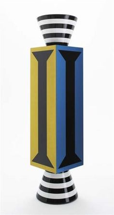 ALESSANDRO MENDINI 'Ollo' column cabinet, 1980s  Painted wood, metallic foil, highly polished varnish, glass. Manufactured by Studio Alchimia, Italy. 211.5 x 45.1 x 45.1 cm. (83 1/4 x 17 3/4 x 17 3/4 in.)