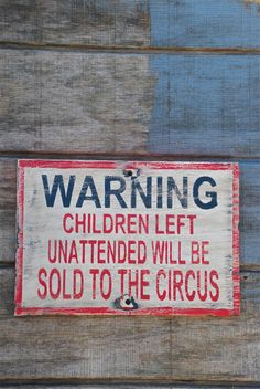 Children will be sold to the circus sign made from reclaimed plywood