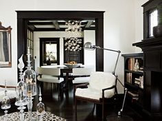 High-gloss black trim work & white walls