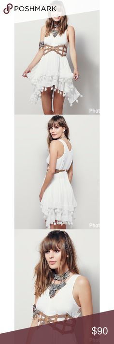 "☀️ Free People ""Sun of Paradise"" dress NWOT ☀️ New, never worn sold out Free People ""Sun of Paradise"" dress with snap-on caged belt and tiered skirt with pom pom tassel detailing.  Just beautiful. Free People Dresses"