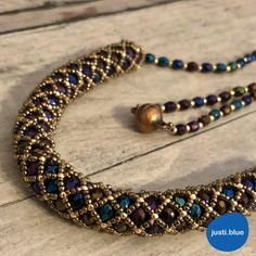Blue-gold tubular netting necklace - What I do in my free timeWhat can you make with tubular netting stitch? I present you a tubular netting necklace in blue and gold shades. Netted Bracelet, Beaded Necklace, Beaded Bracelets, Beaded Jewelry Patterns, Bracelet Patterns, Bead Jewellery, Jewelry Necklaces, Necklace Tutorial, Gold Name Necklace