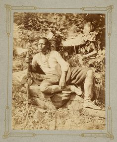 c. 1875 photograph of Pawnee Brave with hatchet and wearing bone necklace and other traditional clothing. Okmulgee, Indian Territory.