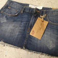 NWT distressed mini denim skirt Super cute H&M distressed denim skirt. Never worn! Size 14Y. H&M Jeans