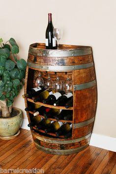 holds 15 bottles - @Angelina Davis... I think we need to order 2 of these! One for you & one for me! What do you think???