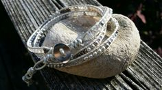 Leather triple wrap bracelet featuring the sparkle of Swarovski crystals and pearls.