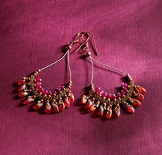Orange Spice earrings, on page 20 of Jewelry Designs with Knitted Wire, uses hollow knitted wire with bead stitching.