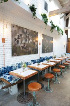 "The Butcher's Daughter is a plant-based restaurant, cafe, juice bar and ""vegetable slaughterhouse Bohemian Restaurant, Bohemian Cafe, Deco Restaurant, Restaurant Interior Design, Resto Vegan, Café Exterior, Cafe Bench, Juice Bar Design, Ideas"