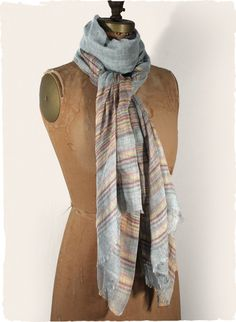 Complete your look with the soft grey modal (90%) and cashmere (10%) shawl, striped in lilac, pink and gold.
