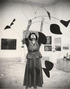 solidair:    Peggy Guggenheim with an Alexander Calder mobile (Photo by Nino Migliori)[via Batchiara]