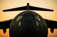 The sun rises above a Boeing C-17 Globemaster III assigned to the 437th Airlift Wing March 24, 2014, at Joint Base Charleston, S.C. The first C-17 to enter the Air Force's inventory arrived at Charleston Air Force Base in June 1993. The C-17 is capable of rapid strategic delivery of troops and all types of cargo to main operating bases or directly to forward bases in the deployment area. (U.S. Air Force photo/Senior Airman Dennis Sloan)