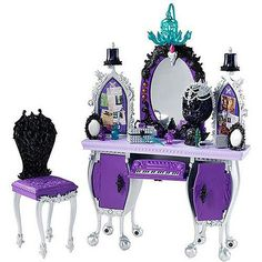 """Raven Queen's Vanity/Desk.  This is too cool.  It even has """"speakers"""" so she can rock out while doing her hair and makeup."""