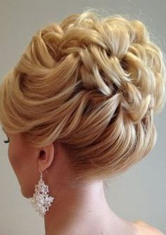 This is a beautiful, chic up-do - perfect for showing off your gorgeous gown on your wedding day!