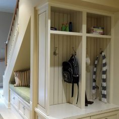 Hall Storage Unit with Seat    Unusual treatment for an under stairs space