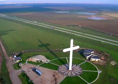 This Giant Groom Texas Cross located along I-40 in Groom, TX is 190 feet tall, 110 feet wide, and visible up to 20 miles away. At 19 stories tall it is one of the largest crosses in the world.