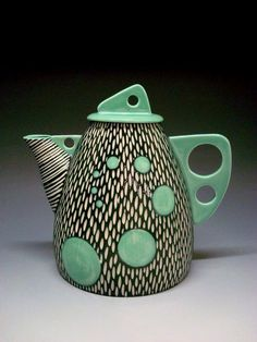 Shoshona Snow Ceramics, I love how the underglaze has been scratched away