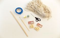 diy macrame wall hanging - awesome - supplies:      70 yards (approx 63m) of rope     a wooden dowel     paintbrush     scissors     painters tape     acrylic paint     large wooden beads