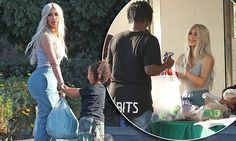 Kim Kardashian and daughter North West deliver food to the homeless