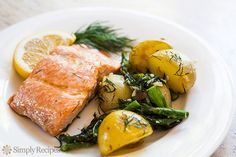 Oven-Roasted Salmon, Asparagus and New Potatoes ~ Salmon, roasted in the oven with new potatoes and asparagus, with olive oil, fresh dill, garlic, and lemon. ~ SimplyRecipes.com