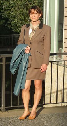 MC in a brown skirtsuit by Pimkie and a blue leather coat.