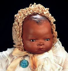 """13"""" bisque Bye-Lo Baby dolls, with brown-complexioned porcelain skin tone and stuffed muslin body, Germany, 1923, by Grace Story Putnam."""