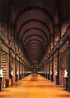 World's Most Beautiful Libraries - Trinity College Library/The Long Room (Dublin, Ireland). Features: The Book of Kells, a manuscript containing the four Gospels of the New Testament. Created by Celtic monks ca. Trinity Library, Trinity College Dublin, Oxford College, College Campus, Dublin Library, College Library, Dublin City, Dublin Travel, Ireland Travel