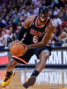 sportingnewsarchive:  Miami Heat small forward LeBron James (6) drives as New York Knicks small forward Carmelo Anthony (7) defends during the first half of an NBA basketball game in Miami, Thursday, Feb. 27, 2014. (AP Photo/Alan Diaz)  More photos of NBA players wearing masks here