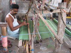 Weaver at a loom...