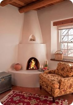 """SW style adobe corner fireplace....I love the shelf on the chimney and the nicho,...don't like the kinda """"sharp edged"""" look to it..."""