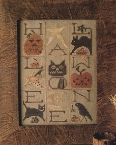 Homespun Elegance- A Halloween Sampler. Love this look! #cross stitch #embroidery sampler