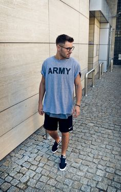 ★★★★★ five stars (light grey graphic tee cuffed sleeves, dark grey tee undershirt, black nike athletic shorts, black adidas sneakers, black bracelet) #masc #binder
