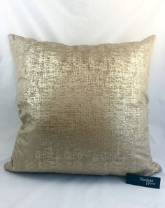 Shiny gold and brown soft pillow (20 in x 20 in)